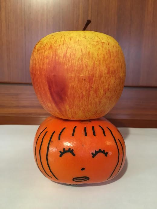 かきの上のりんご