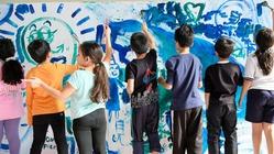 壁を使って、壁をなくす。アートで保見団地に国籍を超えた交流を
