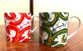 帯屋捨松の帯のデザインのマグカップ